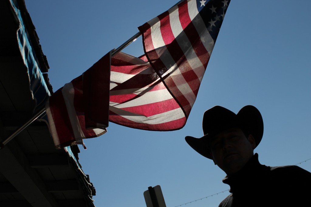 Spanish Cowboy under Old Glory. Scottsdale, AZ.