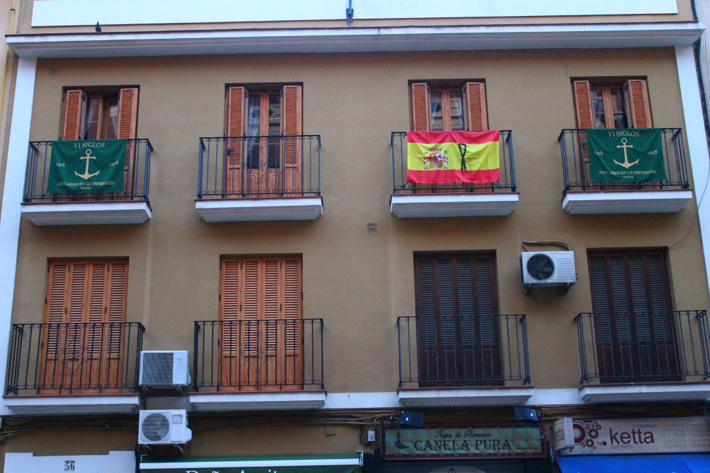 Spanish flags with a black ribbon