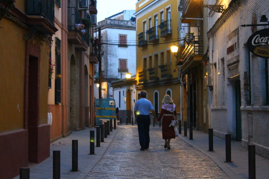 A couple strolls together in Seville, Spain after lockdown measures eased