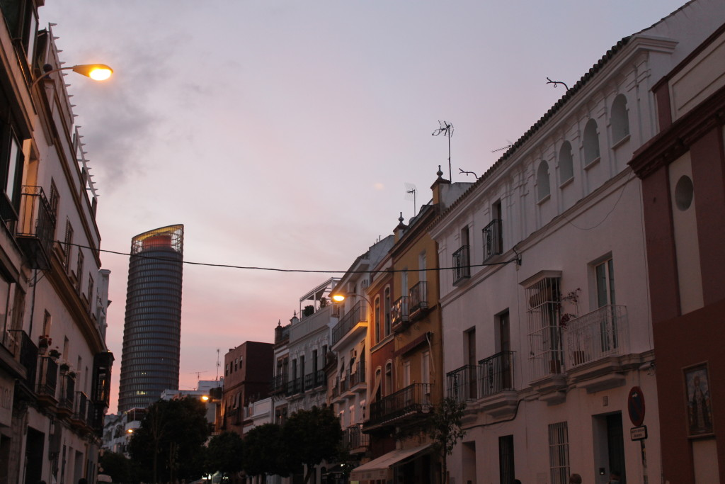 Calle Castilla in the neighborhood of Triana with Torre Andalucía in the background